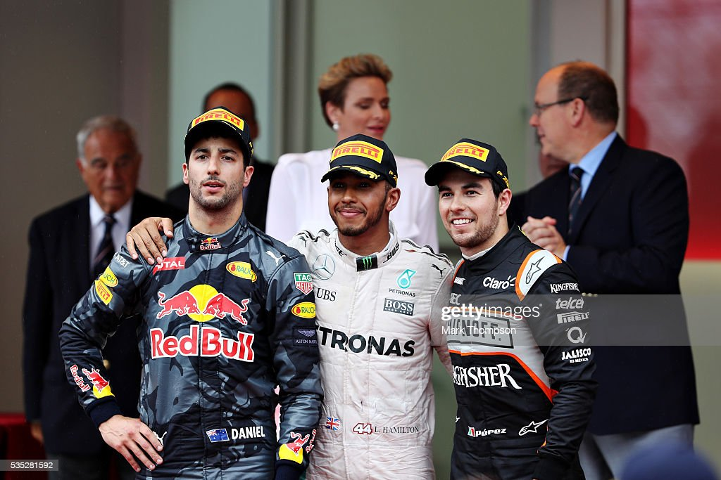 Top three finishers Lewis Hamilton of Great Britain and Mercedes GP Daniel Ricciardo of Australia and Red Bull Racing and Sergio Perez of Mexico and...