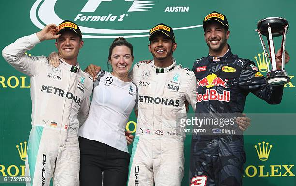 Top three finishers Lewis Hamilton of Great Britain and Mercedes GP Nico Rosberg of Germany and Mercedes GP and Daniel Ricciardo of Australia and Red...