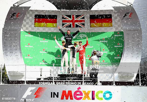 Top three finishers Lewis Hamilton of Great Britain and Mercedes GP Nico Rosberg of Germany and Mercedes GP and Sebastian Vettel of Germany and...