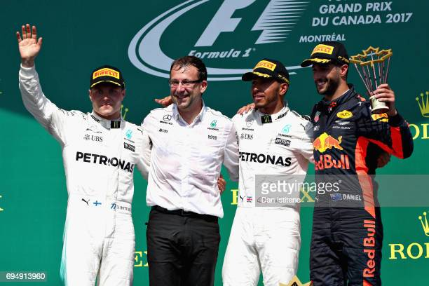 Top three finishers Lewis Hamilton of Great Britain and Mercedes GP Valtteri Bottas of Finland and Mercedes GP and Daniel Ricciardo of Australia and...