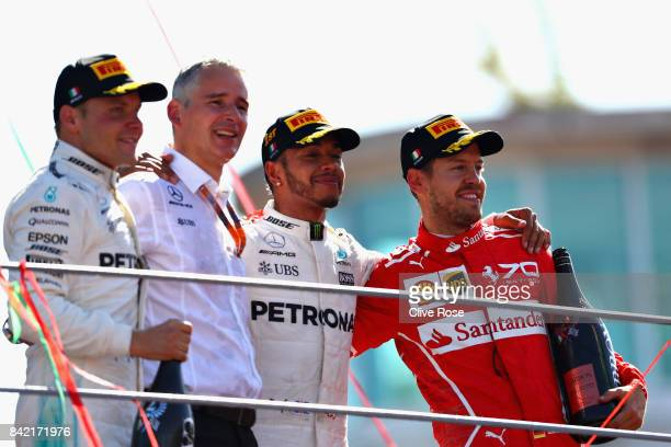Top three finishers Lewis Hamilton of Great Britain and Mercedes GP Valtteri Bottas of Finland and Mercedes GP and Sebastian Vettel of Germany and...