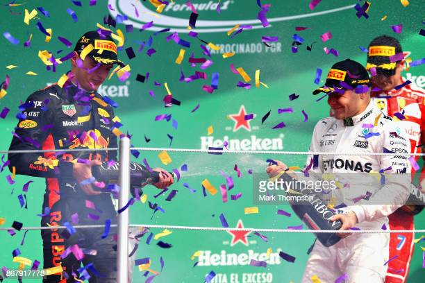 Top three finishers Max Verstappen of Netherlands and Red Bull Racing Valtteri Bottas of Finland and Mercedes GP and Kimi Raikkonen of Finland and...
