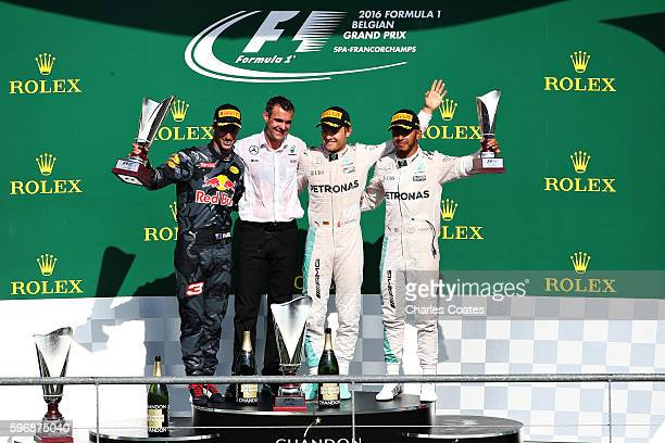 Top three finishers Nico Rosberg of Germany and Mercedes GP Daniel Ricciardo of Australia and Red Bull Racing and Lewis Hamilton of Great Britain and...