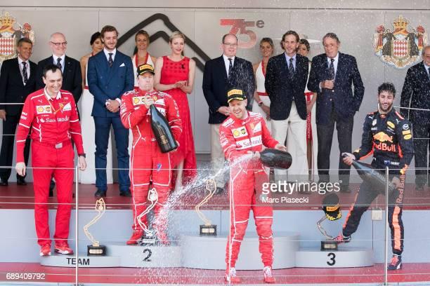 Top three finishers Sebastian Vettel of Germany and Ferrari Kimi Raikkonen of Finland and Ferrari and Daniel Ricciardo of Australia and Red Bull...