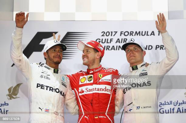 Top three finishers Sebastian Vettel of Germany and Ferrari Lewis Hamilton of Great Britain and Mercedes GP and Valtteri Bottas of Finland and...