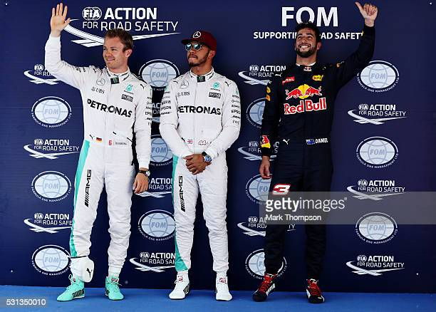 Top three qualifiers Lewis Hamilton of Great Britain and Mercedes GP Nico Rosberg of Germany and Mercedes GP and Daniel Ricciardo of Australia and...