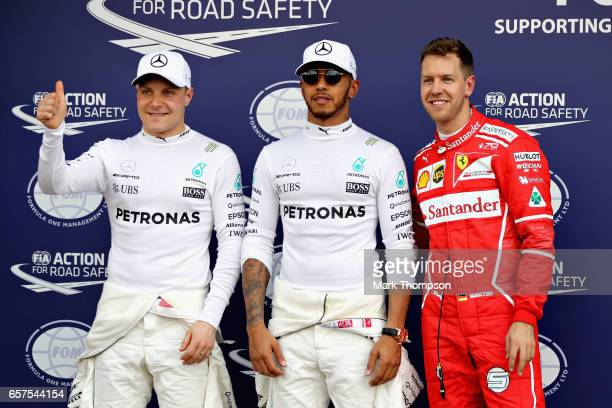 Top three qualifiers Lewis Hamilton of Great Britain and Mercedes GP Sebastian Vettel of Germany and Ferrari and Valtteri Bottas of Finland and...