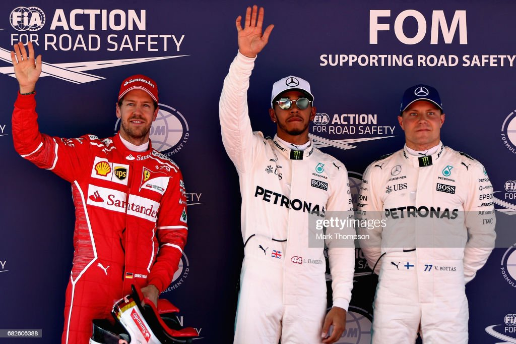 Top three qualifiers Lewis Hamilton of Great Britain and Mercedes GP, Sebastian Vettel of Germany and Ferrari and Valtteri Bottas of Finland and Mercedes GP in parc ferme during qualifying for the Spanish Formula One Grand Prix at Circuit de Catalunya on May 13, 2017 in Montmelo, Spain.