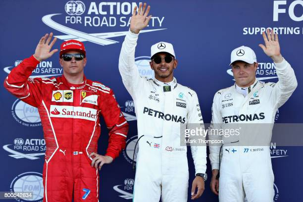 Top three qualifiers Lewis Hamilton of Great Britain and Mercedes GP Valtteri Bottas of Finland and Mercedes GP and Kimi Raikkonen of Finland and...