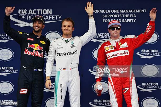 Top three qualifiers Nico Rosberg of Germany and Mercedes GP Daniel Ricciardo of Australia and Red Bull Racing and Kimi Raikkonen of Finland and...