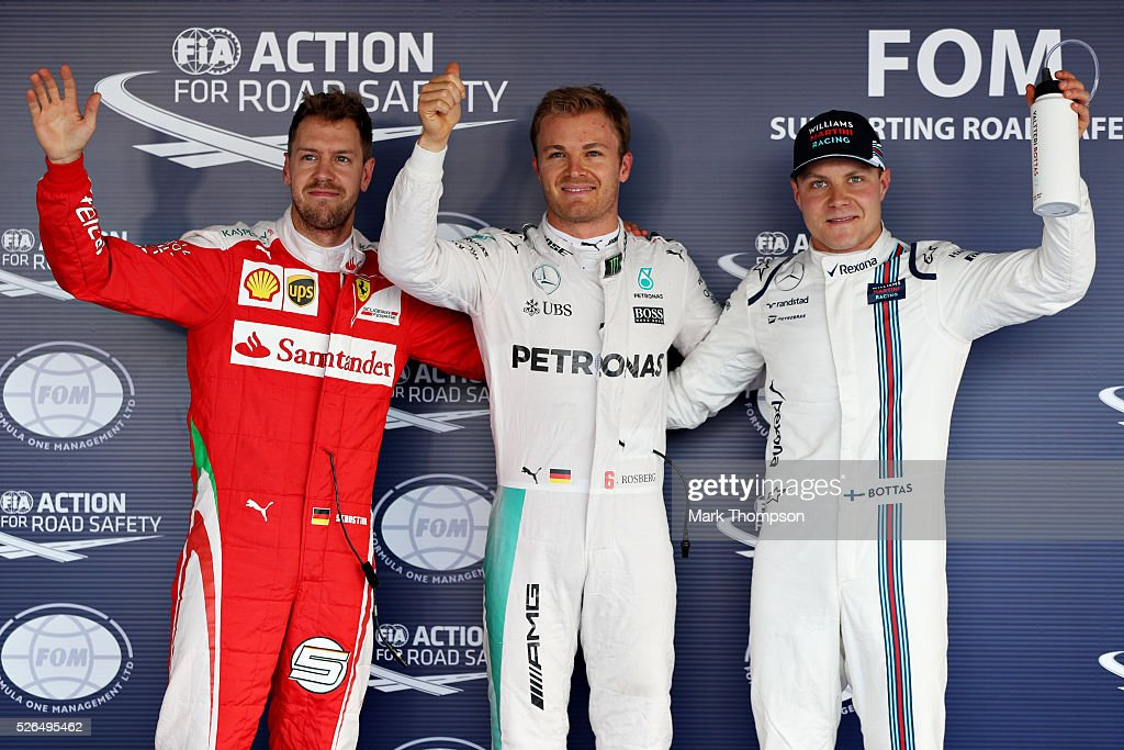 Top three qualifiers, Nico Rosberg of Germany and Mercedes GP, Sebastian Vettel of Germany and Ferrari and Valtteri Bottas of Finland and Williams celebrate in parc ferme during qualifying for the Formula One Grand Prix of Russia at Sochi Autodrom on April 30, 2016 in Sochi, Russia.