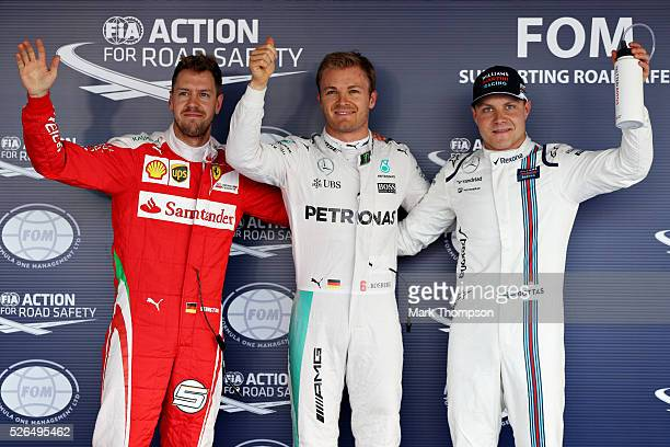Top three qualifiers Nico Rosberg of Germany and Mercedes GP Sebastian Vettel of Germany and Ferrari and Valtteri Bottas of Finland and Williams...