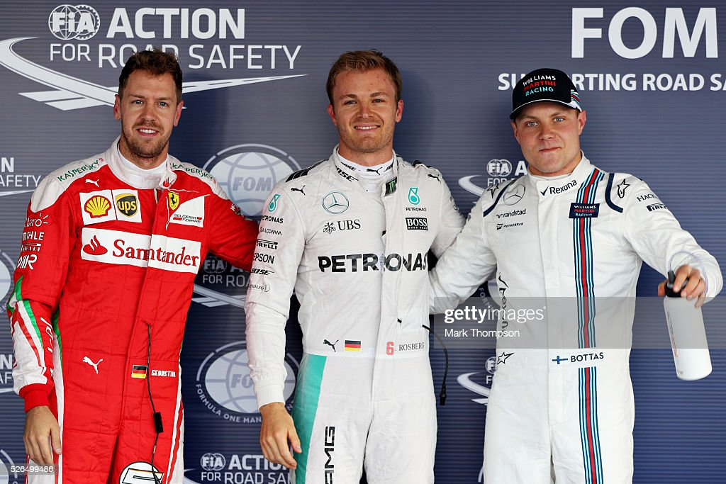 Top three qualifiers, Nico Rosberg of Germany and Mercedes GP, Sebastian Vettel of Germany and Ferrari, and Valtteri Bottas of Finland and Williams celebrate in parc ferme during qualifying for the Formula One Grand Prix of Russia at Sochi Autodrom on April 30, 2016 in Sochi, Russia.