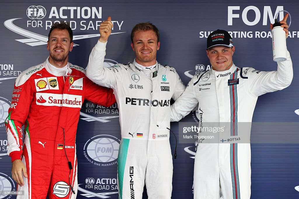 Top three qualifiers Nico Rosberg of Germany and Mercedes GP, Sebastian Vettel of Germany and Ferrari and Valtteri Bottas of Finland and Williams celebrate in parc ferme during qualifying for the Formula One Grand Prix of Russia at Sochi Autodrom on April 30, 2016 in Sochi, Russia.