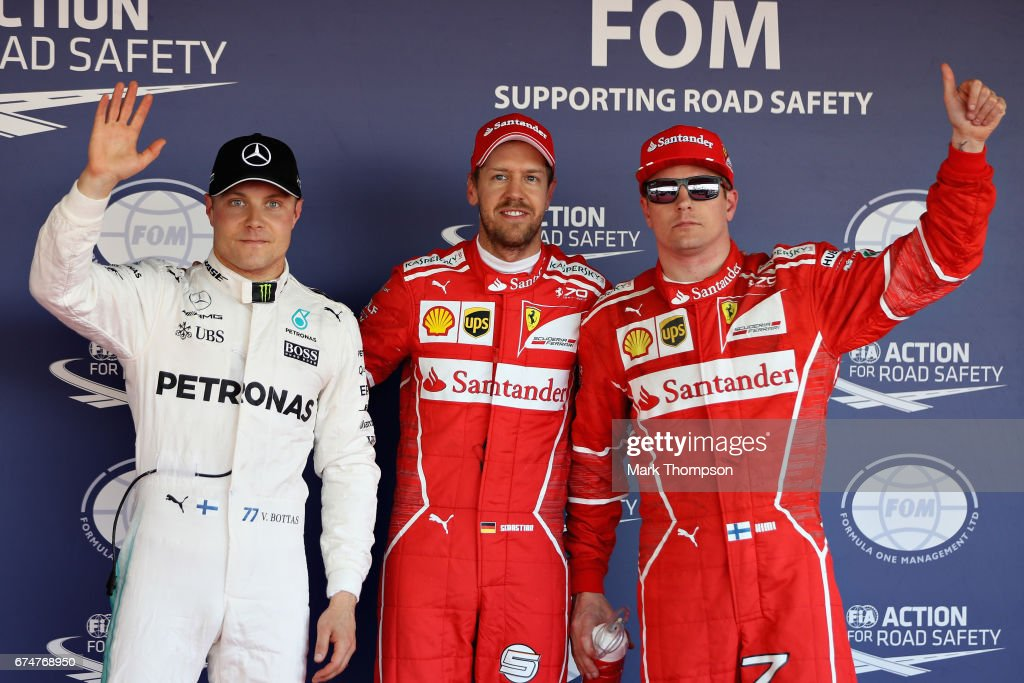 Top three qualifiers, Sebastian Vettel of Germany and Ferrari, Kimi Raikkonen of Finland and Ferrari and Valtteri Bottas of Finland and Mercedes GP in parc ferme during qualifying for the Formula One Grand Prix of Russia on April 29, 2017 in Sochi, Russia.