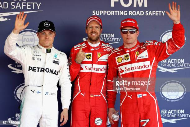 Top three qualifiers Sebastian Vettel of Germany and Ferrari Kimi Raikkonen of Finland and Ferrari and Valtteri Bottas of Finland and Mercedes GP in...