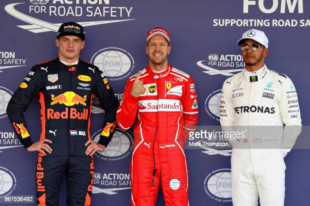 Top three qualifiers Sebastian Vettel of Germany and Ferrari Max Verstappen of Netherlands and Red Bull Racing and Lewis Hamilton of Great Britain...