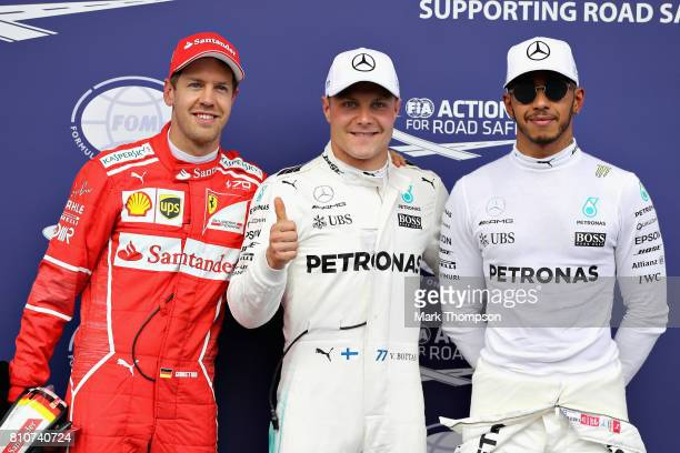 Top three qualifiers Valtteri Bottas of Finland and Mercedes GP Sebastian Vettel of Germany and Ferrari and Lewis Hamilton of Great Britain and...