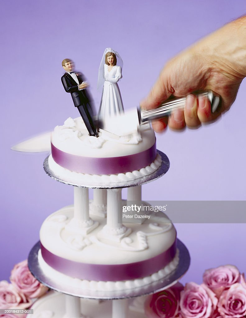 top tier of wedding cake being cut dividing model bride and groom stock photo getty images. Black Bedroom Furniture Sets. Home Design Ideas