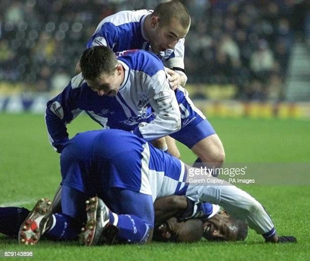 Bristol Rovers' Lewis Hogg Kevin Gall and Mark Walters pipe on Nathan Ellington after his third goal in their 31 win over Derby in the AXA FA Cup...
