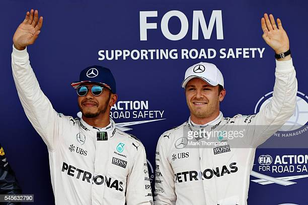 Top two qualifiers Lewis Hamilton of Great Britain and Mercedes GP and Nico Rosberg of Germany and Mercedes GP celebrate in parc ferme during...