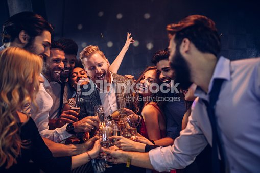 Top up the champagne : Stock Photo