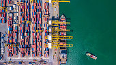 Top view Aerial view of Deep water port with cargo ship and container Singapore