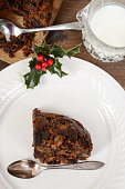 top view christmas pudding with spoon on white plate