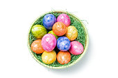Top View - Easter Eggs in Basket on white Background