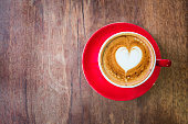 top view Heart latte art hot coffee on old wooden table as love and romantic concept