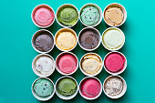 Top view Ice cream flavors in cup on green background