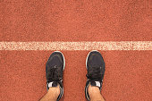 Top view man wear running shoes on the starting line