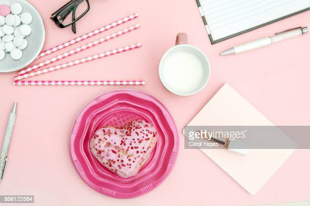 top view milk and heart shape  pink donuts