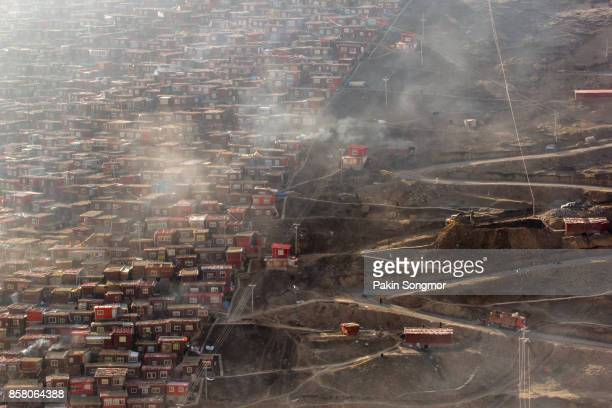 Top view monastery at Larung gar (Buddhist Academy) in a warm and foggy morning time, Sichuan, China