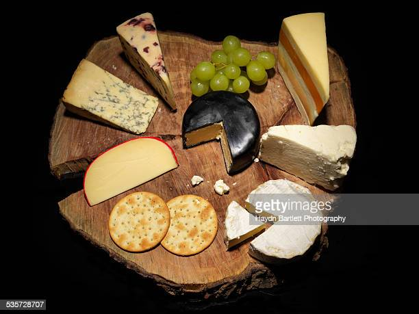 Top view of a cheese platter on black