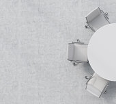 Top view of a half of the conference room. A white round table, three white leather chairs. Office interior. 3D rendering.