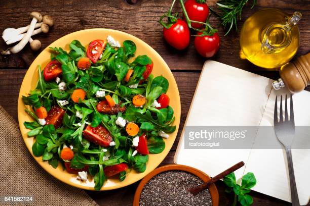 Top view of a healthy salad with chia seeds on rustic wood table