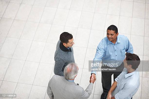 Top view of a successful business partners handshaking at work