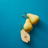 top view of appetizing pears on blue surface