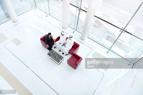 Top view of arab businessmen in meeting, Huge bright room.