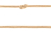 top view of arranged nautical ropes with knot isolated on white
