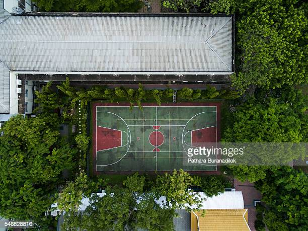 Top view of basketball and sport ground surrounded with tree