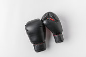 top view of boxing gloves on white tabletop