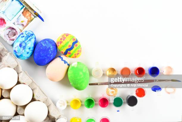 Top View of Colourful Easter Eggs White Background Copy Space