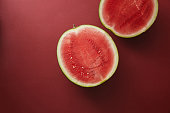 top view of cut watermelon on red surface