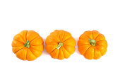 Top view of decorative orange pumpkins, isolated on white background, for Thanksgiving day or Halloween