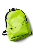 Top view of green school backpack on white background