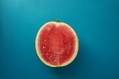 top view of half of watermelon on blue surface