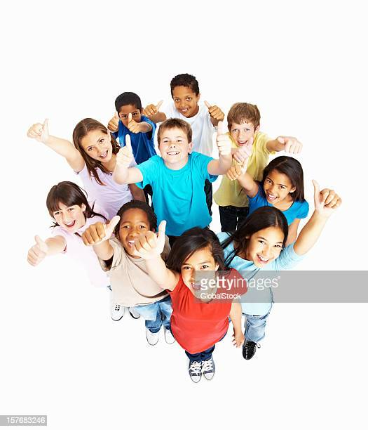 Top view of happy multi racial kids gesturing thumbs up