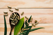 top view of herbal drug and bottle on wood background